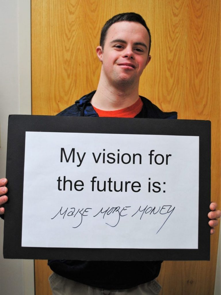 Client with vision statement poster