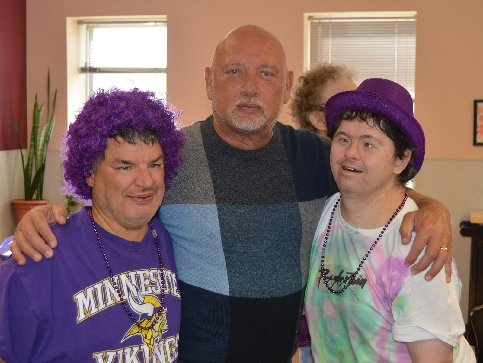 Executive Director John Wayne Barker and clients wearing purple